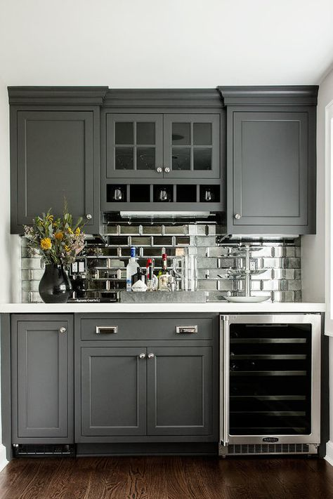 Dry Bar w/glass front mini fridge, mirrored subway tiles- great idea for remodel of outdated wet bar.l