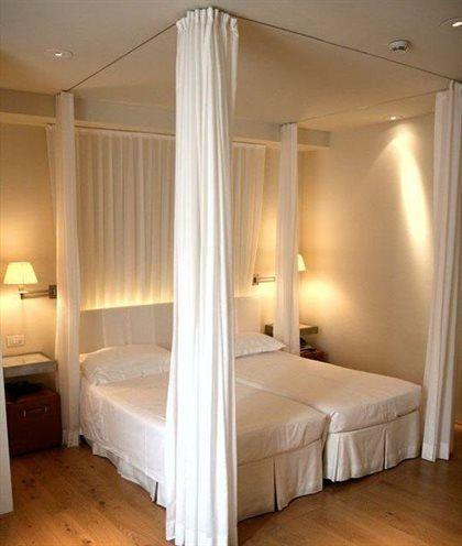 ベッドカーテンを使用して夢のような寝室を作成する方法