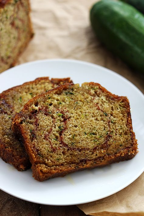 This sweet and ultra moist zucchini bread is bursting with cinnamon swirl flavor and so easy to make! A perfect way to use up leftover zucchinis!