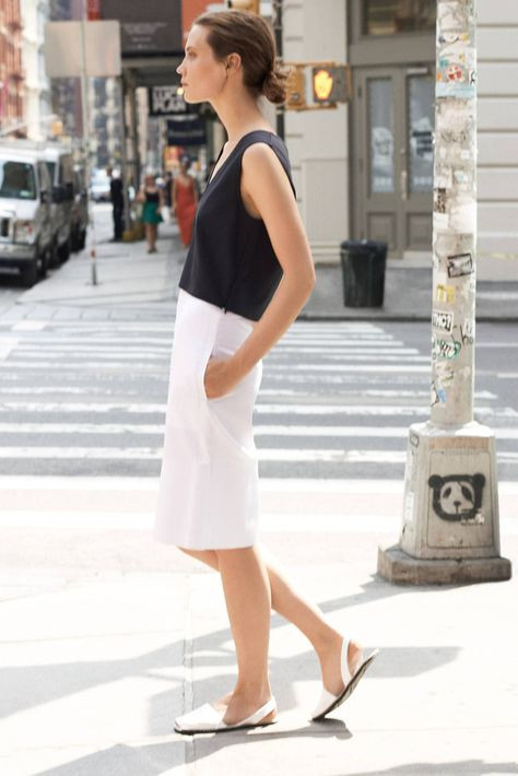 Heat and humidity convince many people to dress for the beach, even in the middle of the city. Resist the temptation to wear as little as possible by relying on refined pieces that don't cling to the body. Tanks in pure silk and cotton twill retain their fluidity or subtle structure even when August is at its steamiest, while intricate perforations allow a textured jersey sweater to breathe. Streamlined sandals, a graphic ring, and a versatile bag provide the finishing touches.