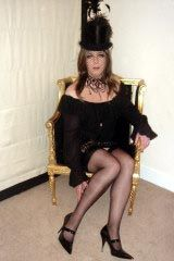 Stunning feminized young man transformed with feminization into a female