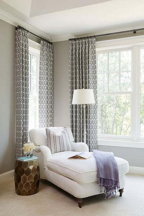 Chic bedroom reading corner is filled with a white roll arm ...
