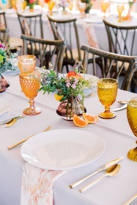 From the editorial A Colorful San Diego Wedding Day With Jaw-Dropping Ocean Views. This couple's beachside ceremony will leave you speechless as will their secluded garden reception! Photography: @arielminphoto #beachwedding #colorfulwedding #weddingtable #weddingtablescape #yellowwedding #weddingdecor