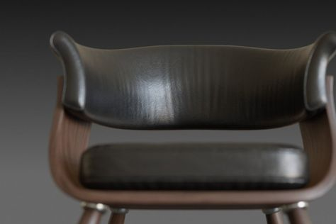 Wooden chair with a dark leather