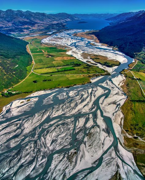 These are the braided rivers that feed off the glaciers that feed Lake Wakatipu here on the South Island of New Zealand. It's pretty fun to go jet boating around here... just up there where the lake begins is where Glenorchy is and just beyond is one of my favorite yoga and meditation retreats called Aro Ha. #TreyRatcliff #NewZealand #Glenorchy #Glacier #Glacial #River #Landscape #SouthIsland #Lake #LakeWakatipu