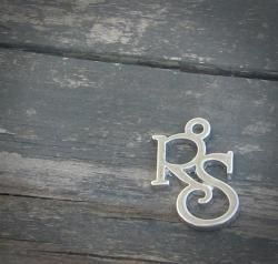 Relief Society Charms   List Price: $1.25  Price: $0.99          Our beautiful Relief Society charms feature the initials 'RS' in a beautiful scripted font similar to the one found on the Relief Society seal. These charms are manufactured using a hypoallergenic zinc alloy that is nickel-free and lead-free and finished with a shiny silver tone coating.  Each RS Charm measures just over 1/2 inch (19mm) wide by a little more than 3/4 inch (20 mm) tall with a 1/16 inch (2 mm) hole. You can easily...