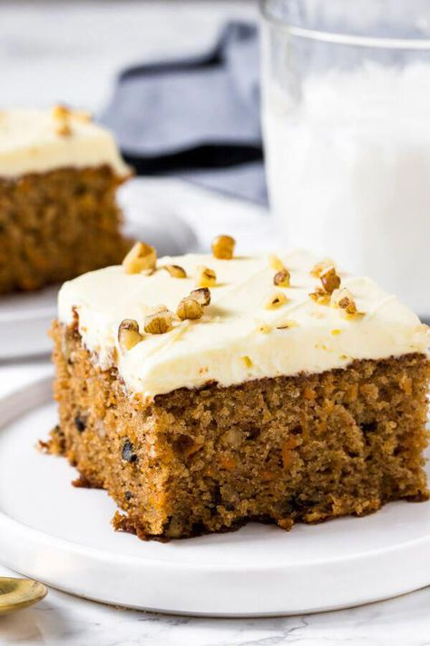This moist carrot cake with cream cheese frosting will be your new go-to recipe. It's tender and soft with a delicious carrot cake flavor and can be made with or without pineapple for the perfect carrot cake recipe! #carrotcake #easter #easterrecipes #dessert #sheetcake #cake #recipes #zucchinicake