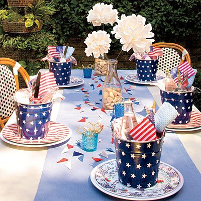 Steal these simple decorating ideas to create a setting that doesn't look simple at all. From playful individual party pails to personalized drinking straws that also serve as place cards, set your table American style. | SouthernLiving.com | #4thofJuly