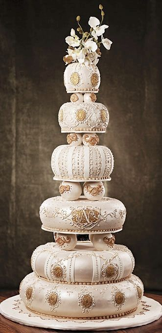 Indian inspired wedding cake. Six layers shaped almost like cushions.  Very elegant. ᘡղbᘡ