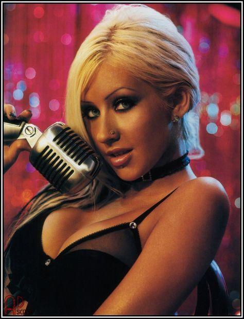 Christina Aguilera...my Andy has a crush on her and her tatas!!!