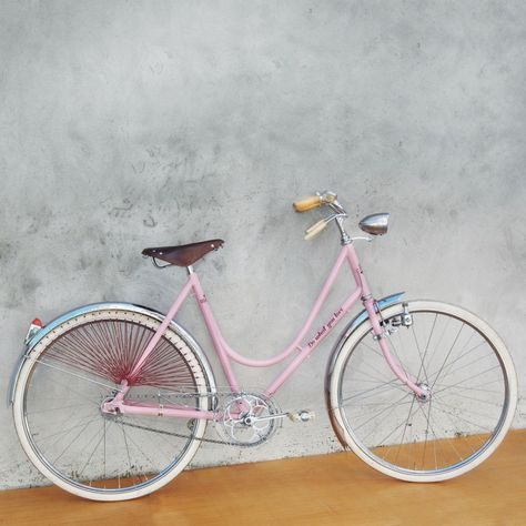 """Ciclografica restores vintage bikes around a theme. The theme of this bike is, """"Do what you love,"""" and the frame is by an old Italian manufacturer, Taurus. I love the red skirtguard with the pink frame--it's so pretty."""