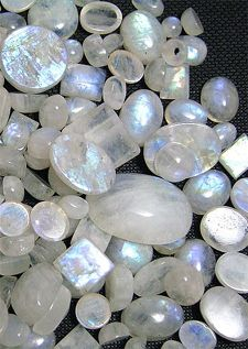 Moonstone is composed of two feldspar species, orthoclase and albite. The two species are intermingled. Then, as the newly formed mineral cools, the intergrowth of orthoclase and albite separates into stacked, alternating layers. When light falls between these thin, flat layers, it scatters in many directions producing the phenomenon called adularescence. Some of the finest Moonstone is from India