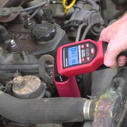 How To Use A Timing Light To Set Ignition Timing Garage Tool Advisor Ignition Timing Ignite Shine The Light