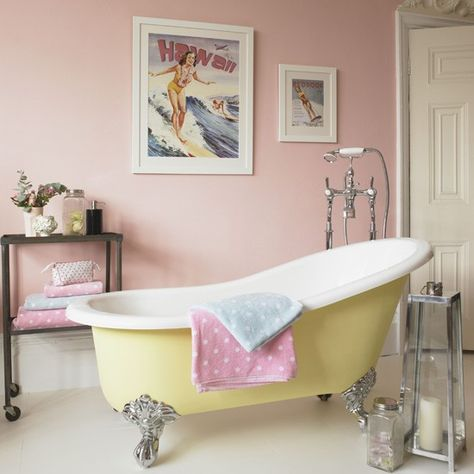 Pink bathroom. Candy pink and lemon yellow create a modern country feel in this bathroom that's feminine and fun. The framed prints and vintage accessories add a retro feel. #bathroom #toilet #shower