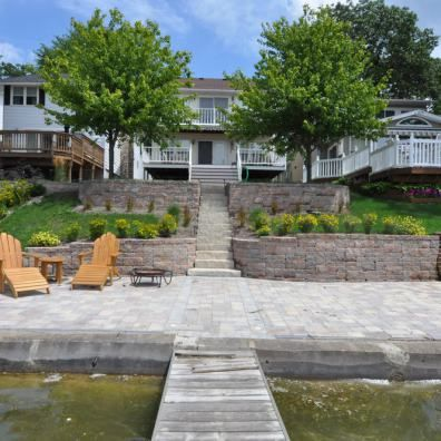 Lakefront Retaining Walls And Steps Wow This Is How It S Done The Chairs Could Easily Be Sitting Landscaping Retaining Walls Lakefront Homes Retaining Wall