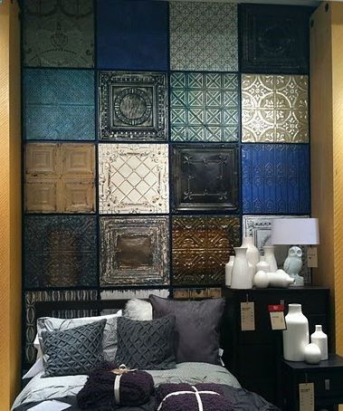 Faux tin tiles from Lowes or Home Depot sprayed with coordinating colors for a cheap accent wall. LOVE.