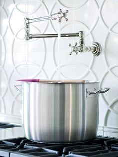 Tired of lugging water-filled pots from the sink to the cooktop? A swing-out tap -- also called a pot filler -- installed near the cooktop fills pots near where you heat them. Or you can install an extra-long hose attachment on your main tap to fill pots on the cooktop