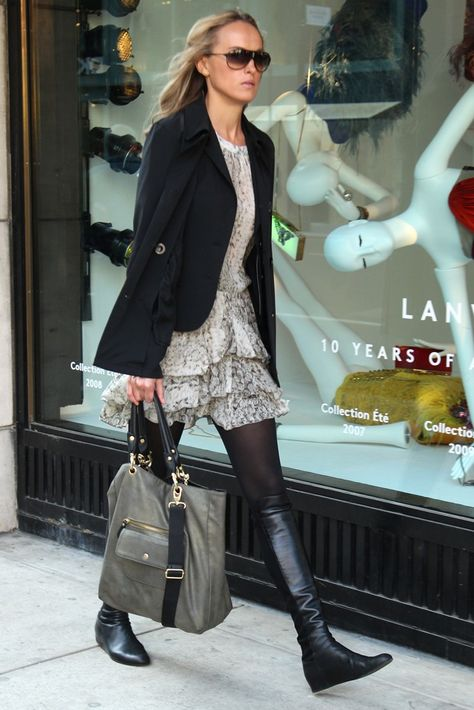 Black jacket over a short lace dress w/ black tights and leather boots <3