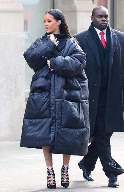 Rihanna looks like two small people, one on top of the other, trying to look older.