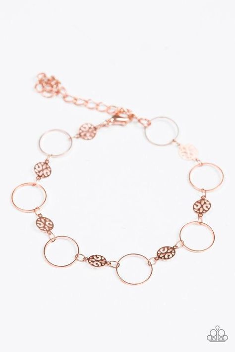 Dainty shiny copper hoops and ornate shiny copper discs link across the wrist in a casual fashion. Features an adjustable clasp closure.