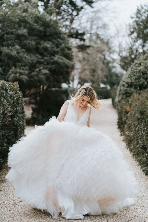 DC Bride 💖 Bride is dancing in a full textured ball gown with layers of ruffles and intricate beadwork for a northeastern spring wedding. #DCwedding #textutredballgown #ruffledweddingdress #Bridalgown