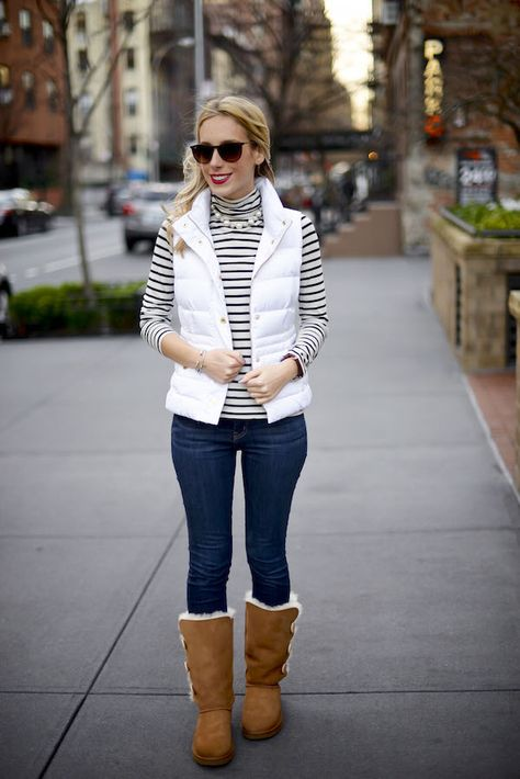 Katie's Bliss styles a cute and casual winter outfit wearing UGG bailey button boots and a white Lilly Pulitzer puffer vest.