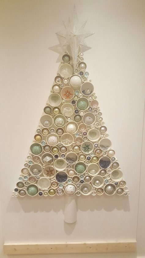 My take on the Pipe Christmas tree that I found here on Pinterest . So much work but so much fun. This is on an 8 foot mdf board to give some idea of scale....thats a lot of pipes