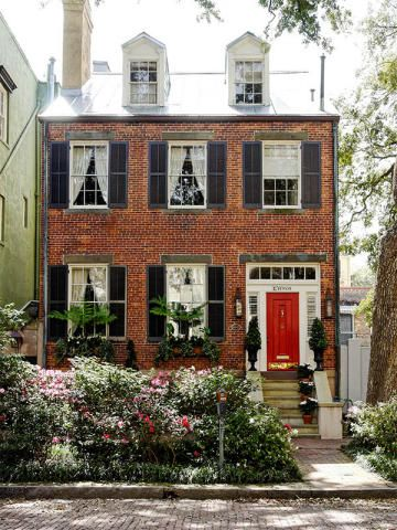 Love the style of the home, and the red door is fantastic. Gorgeous landscaping.