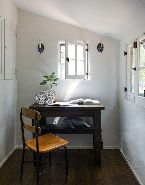 Rustic Southwestern Work Space: Small wooden desk in window lit room..