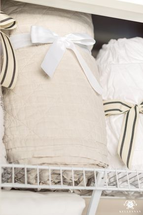 A Small Organized Linen Closet And Ideas To Store Bulky Bedding Kelley Nan Organizing Linens Blanket Storage Linen Closet,Dark Blue Wall Living Room Ideas