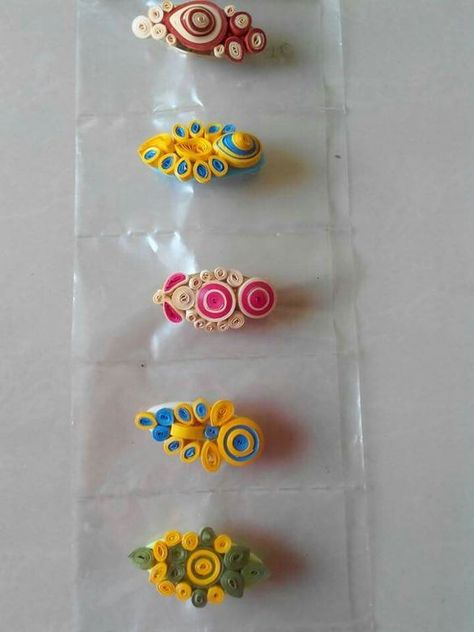 Simple pins can be decorated with quilled flowers and other shapes. Even with less efforts, you can have awesome designs adding to the beauty of your dresses. Here, is collection of some simple and elegant