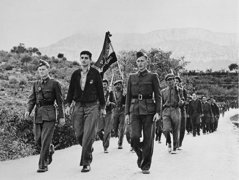 Robert Capa     The Abraham Lincoln Brigade, American Unit of the Anti-Fascist International Brigades, led by Milt Wolf (front row center), Preparing to Leave Spain, near Barcelona     1938