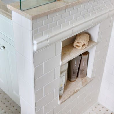 built in lower shelves for shower on half wall