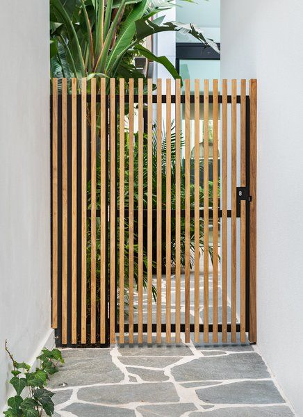 Outdoor, Vertical Fences, Wall, Landscape Lighting, Pavers Patio, Porch, Deck, Shrubs, and Side Yard Rosewood garden gate. Unsealed , the rosewood with grey naturally over time. Cloud House by Jacqueline Perrett
