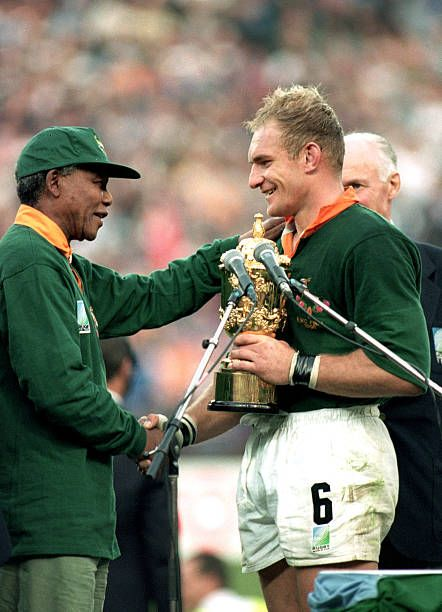 Captain Francois Pienaar Of South Africa Receives The William Webb Ellis Cup From The South African Presid Nelson Mandela Quotes Mandela Quotes Rugby World Cup