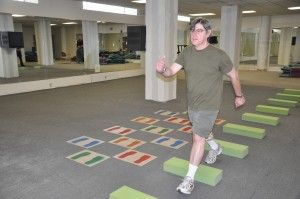 """Gait Training Parkinson's Disease Visual Cues. """"Many of the motor symptoms that people living with Parkinson's Disease experience can be primarily attributed to low levels of dopamine in the region of the brain called the Basal Ganglia. This region of the brain is responsible for unconscious rhythmic movement. The most common unconscious rhythmic activity performed by humans is walking, also referred to as gait."""""""
