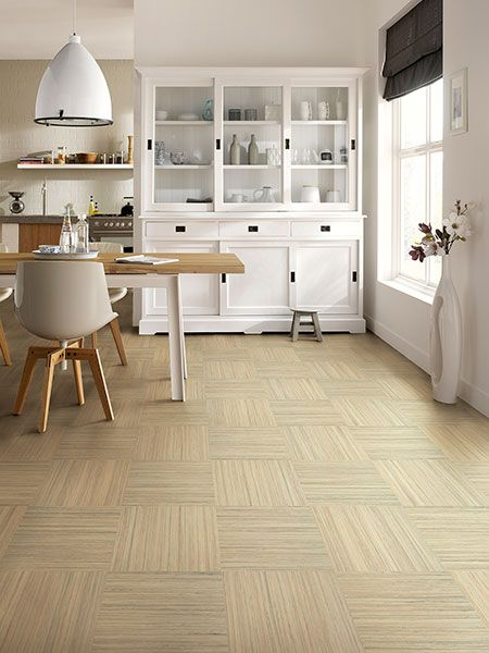 linoleum kitchen floor in squares turned 90 degrees to each other in a bamboo colored basketweave pattern