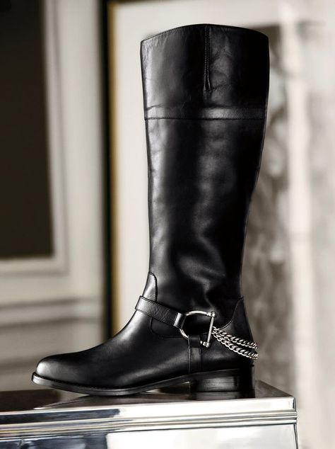 Crafted from burnished leather, this equestrian-style Lauren Ralph Lauren riding boot features polished stirrup-inspired metal accents with a gleaming draped chain.