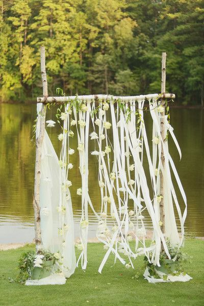 A beautiful outdoor wedding altar! A wooden arch draped with fabric, ribbon & flowers. {@jnwfoto}