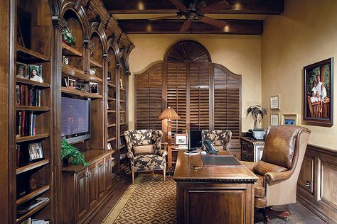 Incredible home office with plenty of wood.  Having a TV like that is either a really good idea or really bad idea... depending on whether you want to actually work.