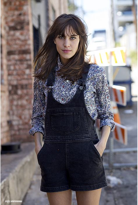 Alexa Chung looking effortlessly cool (as usual) in black denim overalls / dungarees.
