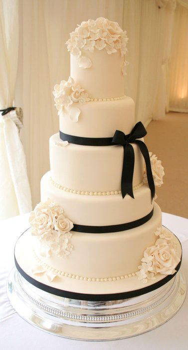Ivory floral wedding cake on our Silver round cake stand- Cake by allaboutcake