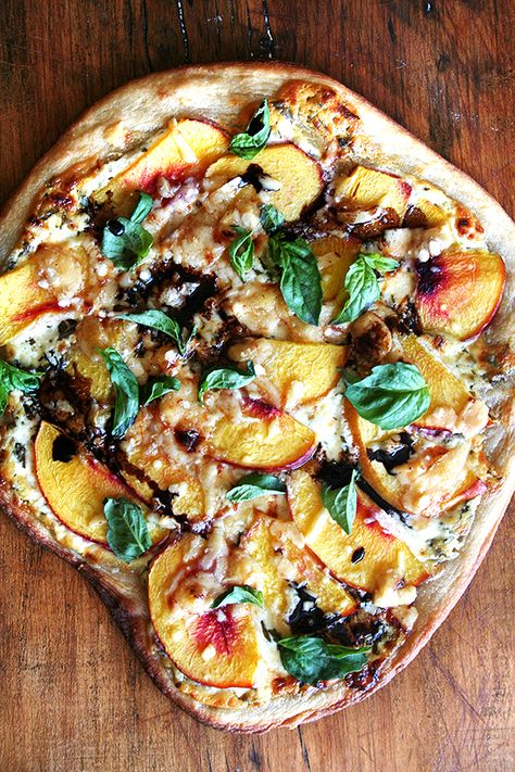 Pizza, out of the oven sprinkled with basil and drizzled with balsamic