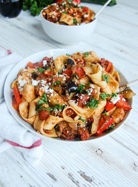 Ratatouille Pappardelle: A combination of zucchini, ratatouille and tomatoes are slowly simmered in spices to create a beautiful late summer sauce that is tossed with pappardelle and topped with freshly chopped parsley and crumbled feta cheese.// A Cedar Spoon