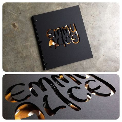Custom graphic design portfolio book with cut-out treatment on matte black acrylic by kloportfolios.com