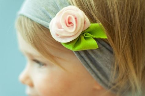 Truffle sized rose attached to a stretchy headband.