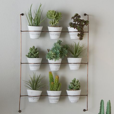 """Make use of vertical space with this clay pot wall rack. The Copper wire rack pairs beautifully with the Whitewash pots which are perfect as either a unique storage option, or a way to add easy-to-maintain greenery to rustic, modern, and contemporary rooms. (21""""Hx15.5""""Wx3.5""""D). Pots (3""""Hx3.5""""Wx3.5""""D). Herb Wall, Indoor Plant Pots, Indoor Gardening, Wall Herb Garden Indoor, Wall Hanging Plants Indoor, Hanging Plant Wall, Wrought Iron Decor, Tuscan Design, Tuscan Style"""