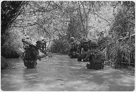 Vietnam war | Vietnam War Timeline I think these soldiers are on patrol looking for enemy soldiers and walking up the river so they can avoid booby traps. Like punji sticks and trip wires. I wonder where they are walking to?