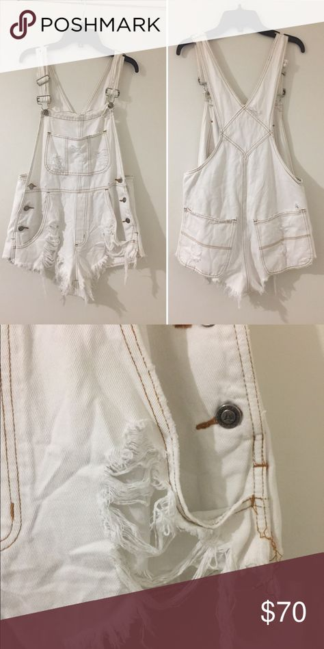 LF/ first of a kind white destroyed overalls. LF/First of a kind white destroyed short overalls. New without tags.  This is one size fits all. I would say it's a size small- medium. It can be worn baggy with a little cropped top under it. LF Shorts Jean Shorts