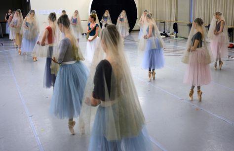 The Wilis encircle Queen Myrtha. Principal Dancer Heather Ogden with Artists of the Ballet. Photo by Daniel Neuhaus.